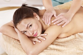 Young woman having classical massage.